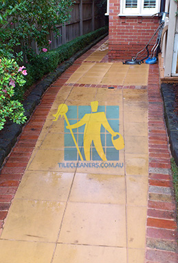 outdoor sandstone tiles pavers wet from cleaning with quarry tiles around melbourne